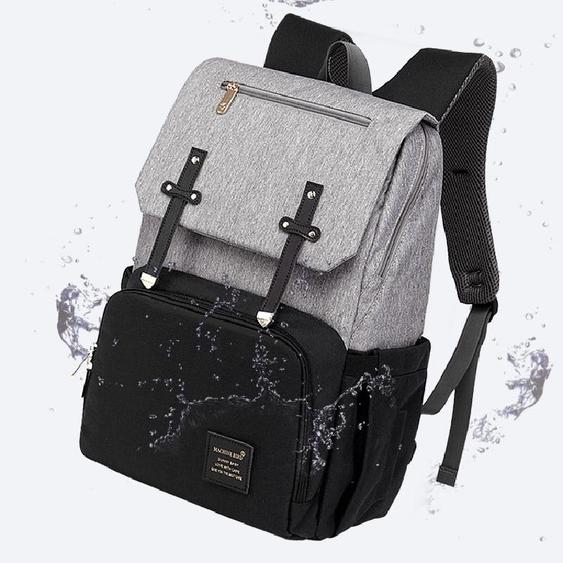 HTB1Gg.MaULrK1Rjy1zbq6AenFXaq Diaper Bag Mummy Daddy Backpack Baby Stroller Bag Waterproof Oxford Handbag Nursing Nappy Kits Maternity Bag USB Warmer Holder