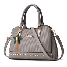 купить Handbags Women Bags Solid 2018 New Design Female Messenger Shoulder Bag rivet Tote bag по цене 1570.75 рублей