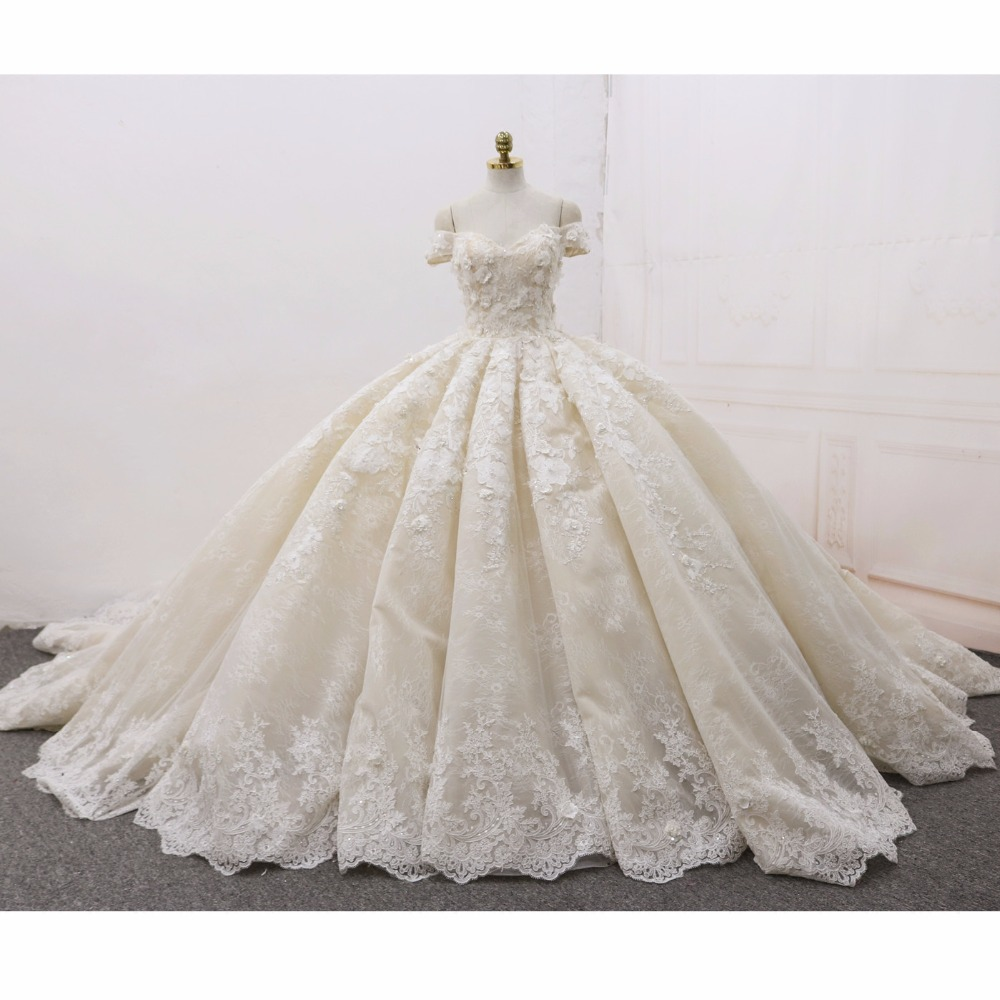 Ball Gown Luxury Wedding Dresses Arabic 2018 Real Photo 3D Floral Handmade  Flowers Chapel Train Tulle Sleeveless Bridal Gowns-in Wedding Dresses from  ... fa56488b6a53