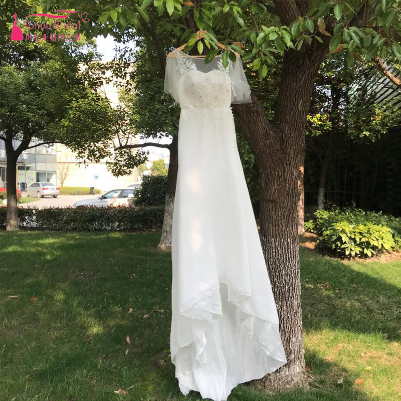 2cf32e4ddc Jewel Bohemian Wedding Dresses 2018 Beach Puff Sleeve Lace Chiffon Bridal  Wedding Gowns Open Back Long Tail Gelinlik ZW027