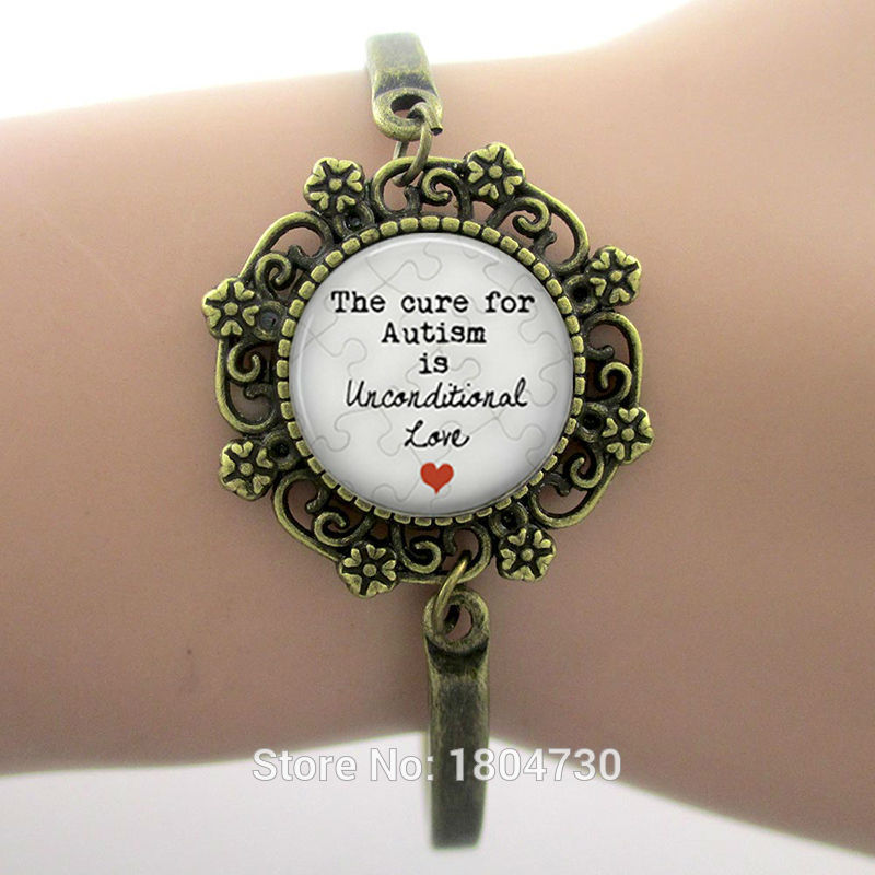 The cure for Autism is <font><b>unconditional</b></font> <font><b>Love</b></font> Glass Dome Lace Charm Bracelet Phrase Art Photo Design Silver Plated High Quality