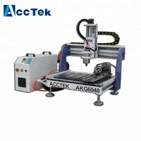 Wholesale low cost 6040 cnc router 1.5kw water cooling mini cnc router for advertising industry