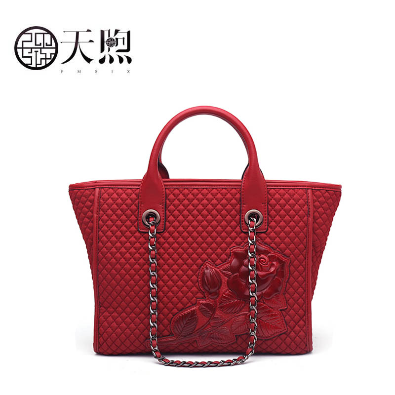 Pmsix 2018 new large-capacity ethnic wind embossed mobile handbag branded handbagPmsix 2018 new large-capacity ethnic wind embossed mobile handbag branded handbag