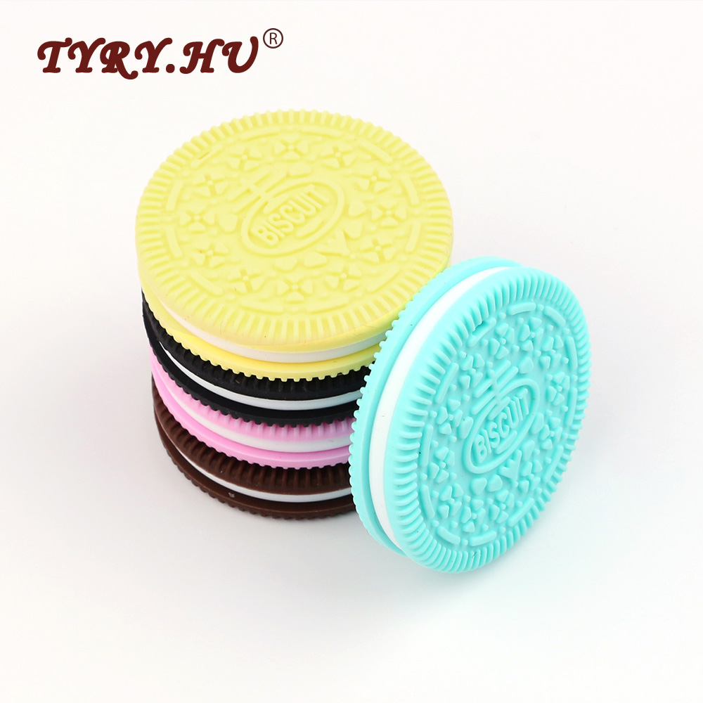 582edd5d6ec HU Muiticolor Cookie Shaped Silicone Teether BPA Free Food Grade Silicone  Materials Healthy Baby Chewed Teether For Baby