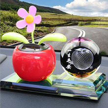 Automobile interior decoration pendulum solar energy shaking head flower car creative automotive supplies