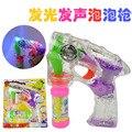 2015 caliente eléctrica pistola de burbujas con transparente music luz intermitente niños burbuja juguete
