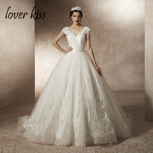 Купить с кэшбэком Lover Kiss Vestido De Noiva 2019 Tulle Lace Cap Sleeve Wedding Dresses Princess Church Bridal Gowns trouwjurk robes mariages