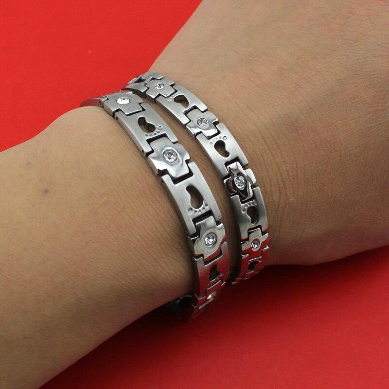 2017 Neue Heißer Verkauf Paare Geschenk Silber Magnetische Zelle 316l Edelstahl Fußabdrücke Kreuz Armband Armreif S0021 Großhandel Duftendes Aroma In