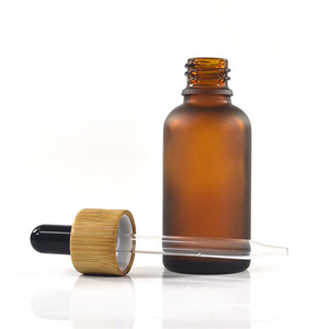Image 5 - 100pcs 30ml essential oil glass bottle 1oz glass dropper bottle with bamboo cap glass essential oil bottle cosmetic packaging