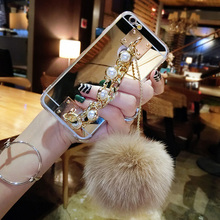 Scorching For i6 i7 Circumstances Luxurious Bling Pearl Chain Fur Ball Gold Mirror Tender TPU Cellphone Case For Iphone 5S 6 6S Plus 7 Plus Again Cowl