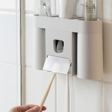 Wall-Mounted Punch Free Plastic Toothbrush Holder Automatic Toothpaste Dispenser Suction Wall Storage Shelf
