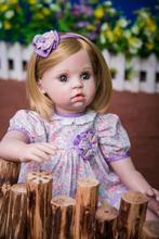 Muñeca reborn de 60 cm con vestido lila
