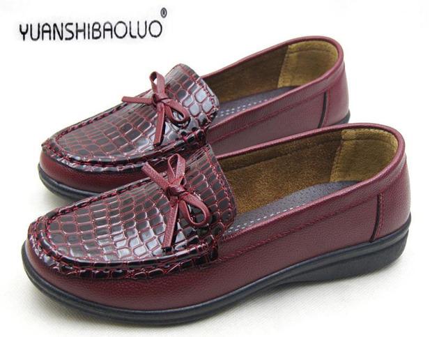 La primavera y el otoño quincuagenario cuero genuino de fondo plano solos zapatos cómodos zapatos de las mujeres talón plano de la abuela