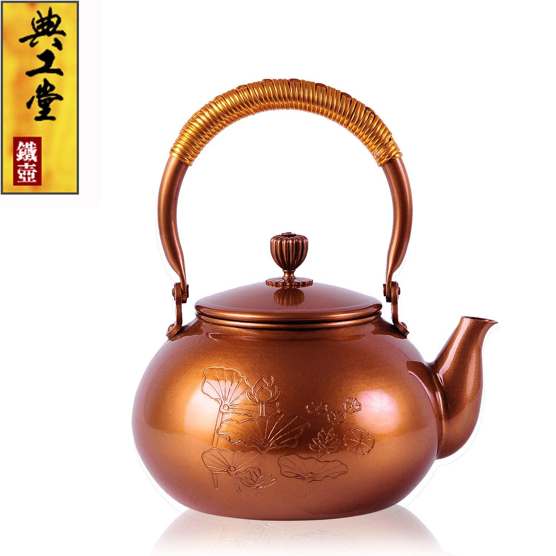 2016 Tetera de hierro fundido juego de té japonés de Kung Fu sin recubrimiento hecho a mano Japón loto púrpura tetera con filtro gran oferta