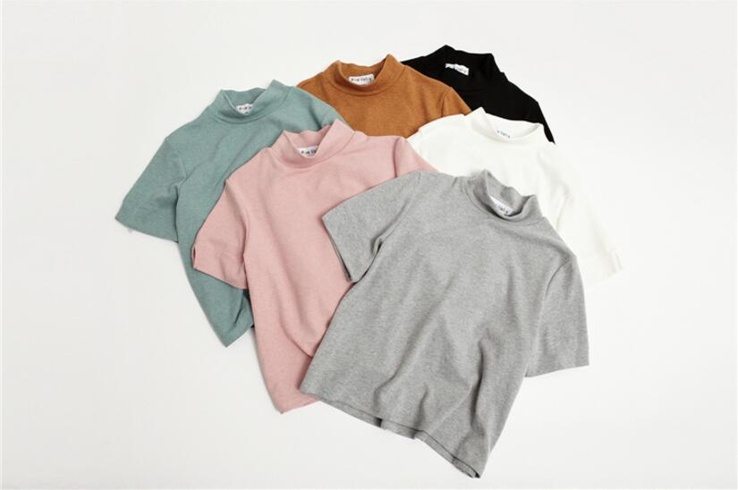 Primavera nuevo color sólido salvaje de manga corta t-shirt