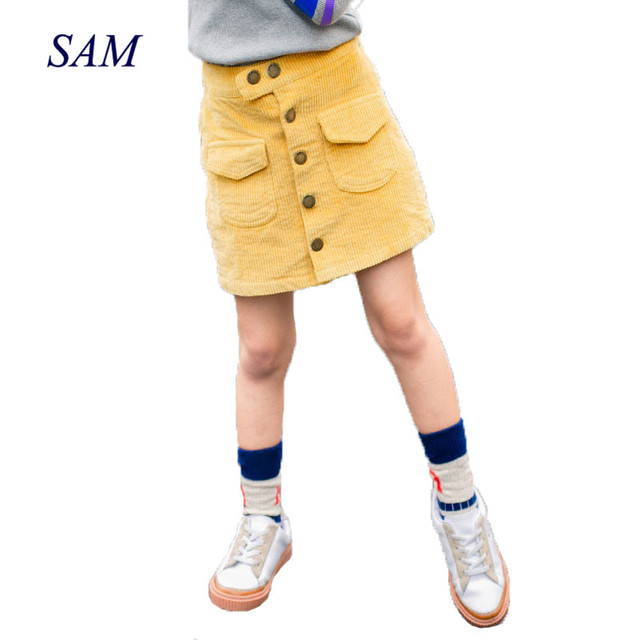 2019 新カジュアル子供のスカートの女の子秋ボタンポケットコーデュロイスカート半身ヒップスカート子供のための