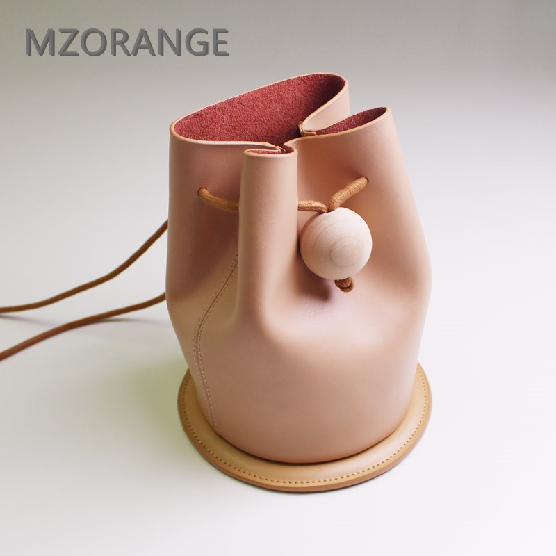 MZORANGE Simple style customized genuine leather women Bucket bag vintage with log ball Design shoulder bags lady Crossbody Bags 2017 new unique design women bucket bag 100% genuine leather handbag simple fashion style lady lente tote shoulder crossbody bag