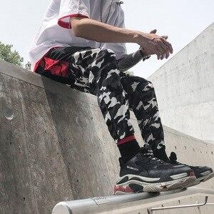 Image 4 - צבע בלוק טלאים Camo מכנסיים אצן גברים של 2018 חדש ירך ירך Streetwear מטען מכנסיים מותג מעצב Hiphop מכנסיים WS172