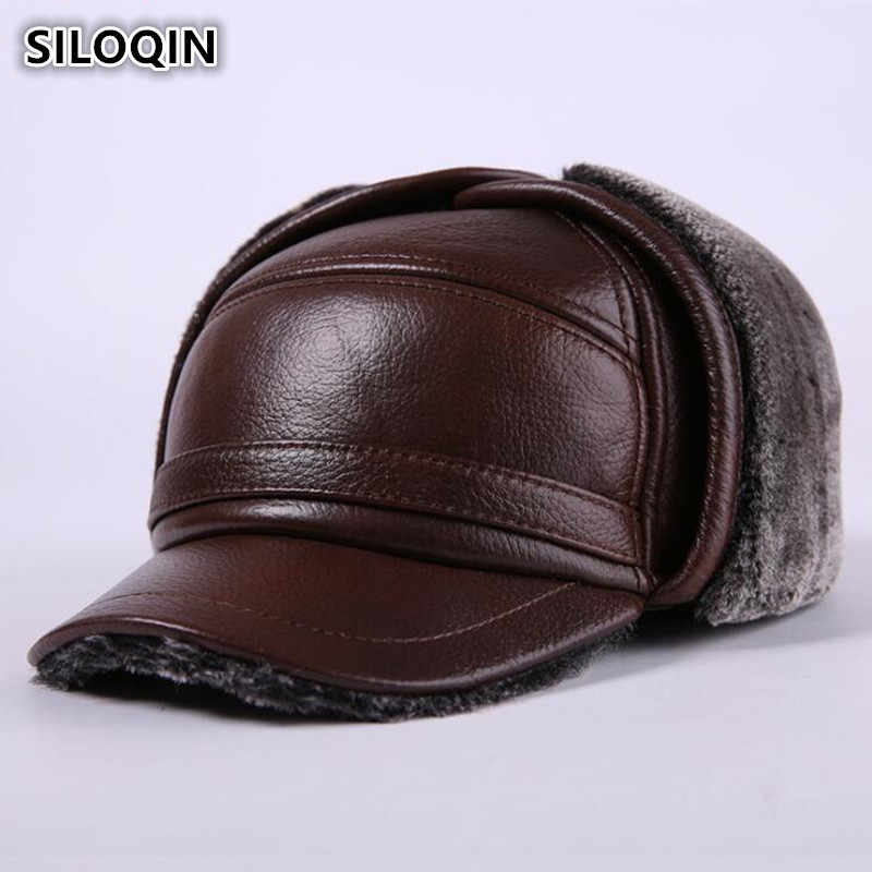 a5b95b80523 SILOQIN New Winter Men s Genuine Leather Hat Thicken Warm Cowhide Leather  Baseball Caps With Ears Dad s