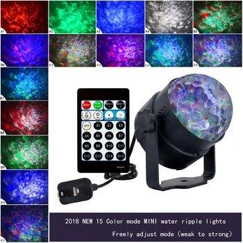 1b6684e1ba6 9 W RGBW 15 colores LED onda de agua ondulación efecto etapa luz láser  proyector luz Navidad partido del acontecimiento del Disco Aurora luces  láser