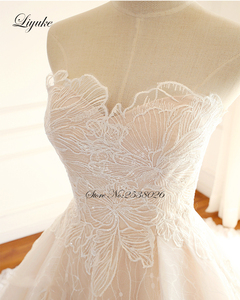 Image 5 - Liyuke Embroidery Strapless A Line Wedding Dress Floral Print Lace Elegant Bridal Dress  Lace Up with Court Train