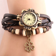 цена Vintage Four-leaf clover Pendant Watch Imitation Leather Bracelet Women Watches Wooden Bead Ladies Wrist Watch Women reloj mujer онлайн в 2017 году