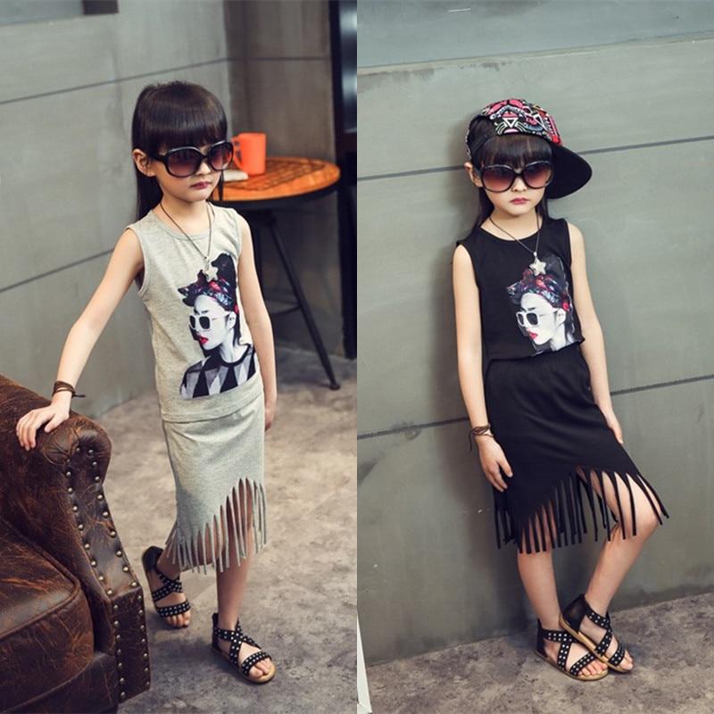 Jaunas modes bērnu meiteņu vasaras drēbes nosaka pušķu apģērbu komplektu ar drukas kreklu ar pušķi uz bērniem un bērniem