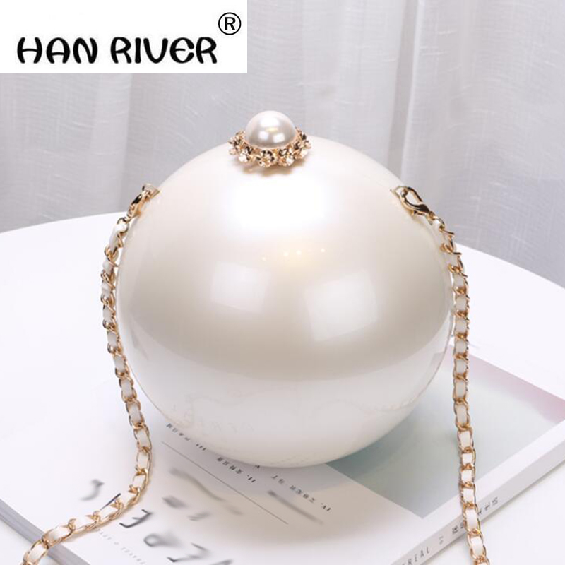 The new fashion hand in 2018 enhances the quality pearl makeup girl bag acrylic hard box earth shoulder slant straddling the girl from hard times hill