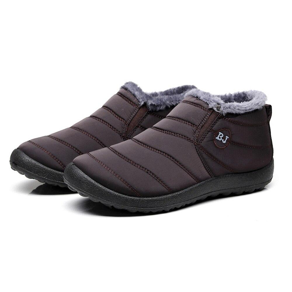 2018 nuevos zapatos de invierno de moda para hombre botas de nieve de Color sólido de felpa interior antideslizante inferior mantener calientes botas de nieve tamaño 39-46