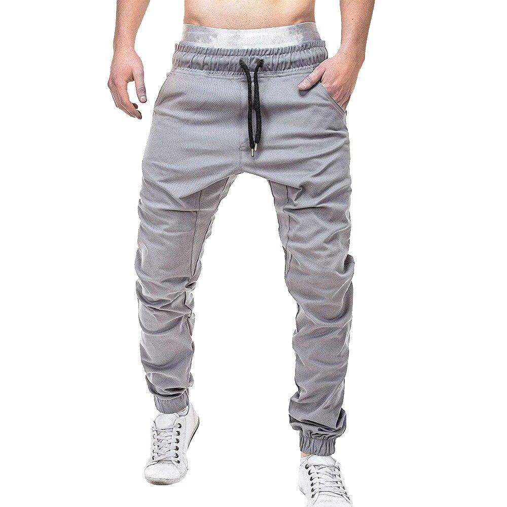 Homens Sweatpants calças Elásticas Casuais Bolsos Calças Baggy Jogging Esporte Sólida 4.12
