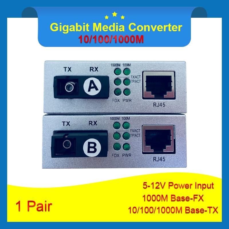 1 คู่เงิน Gigabit Fiber Optical Media Converter 10/100/1000 Mbps เดี่ยว 1310nm/ 1550nm SC พอร์ต 20 กิโลเมตร 5 12 โวลต์-ใน อุปกรณ์ไฟเบอร์ออปติก จาก โทรศัพท์มือถือและการสื่อสารระยะไกล บน AliExpress - 11.11_สิบเอ็ด สิบเอ็ดวันคนโสด 1