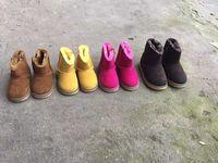 Nieuwe winter meisjes laarzen katoen gevoerde jongens schoenen klassieke kind snowboots dikker thermische goede kwaliteit zeer warm