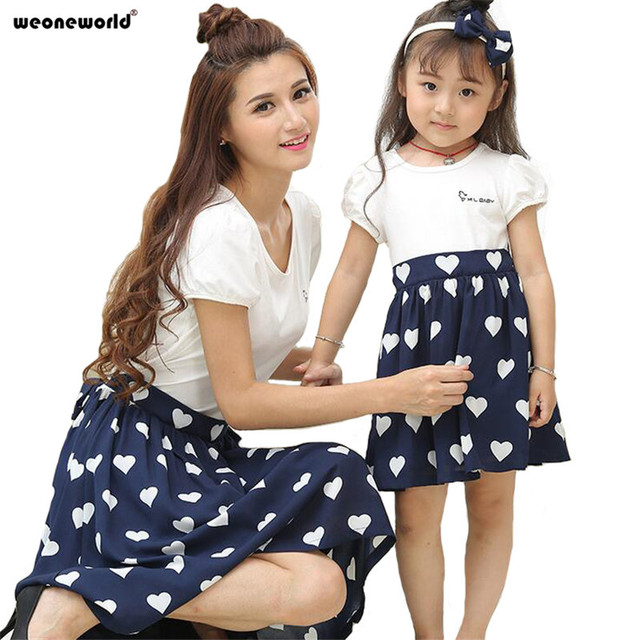 c41be054c6ff WEONEWORLD 2018 Summer Mother Daughter Dresses Fashion Matching Mother  Daughter Clothes Short Sleeve Polka Dot Family Clothing