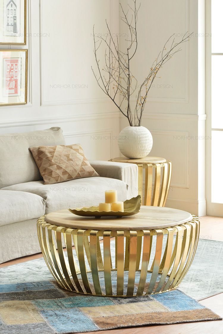 The sitting room tea table. Round, wrought iron golden. Do old coffee table.