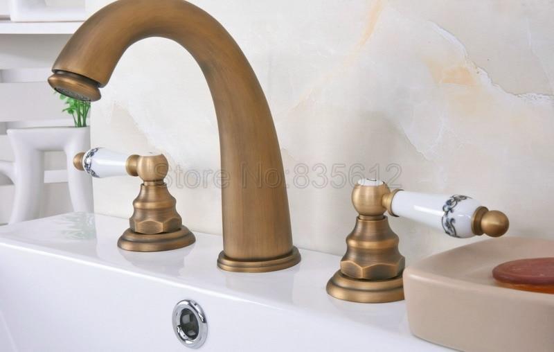Antique Brass Bathroom Basin Sink Faucet Brass Finish Widespread Mixer Taps Dual Ceramic Handle Wan079Antique Brass Bathroom Basin Sink Faucet Brass Finish Widespread Mixer Taps Dual Ceramic Handle Wan079