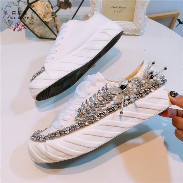 欧州駅新水ドリル重工業純粋なマニュアル文字列の真珠平底キャンバスシューズ 100 ラップレジャー風厚いソル  グループ上の 靴 からの レディースフラット の中 1