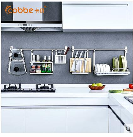 The kitchen shelf wall is covered with a stainless steel hook for the use of a biter