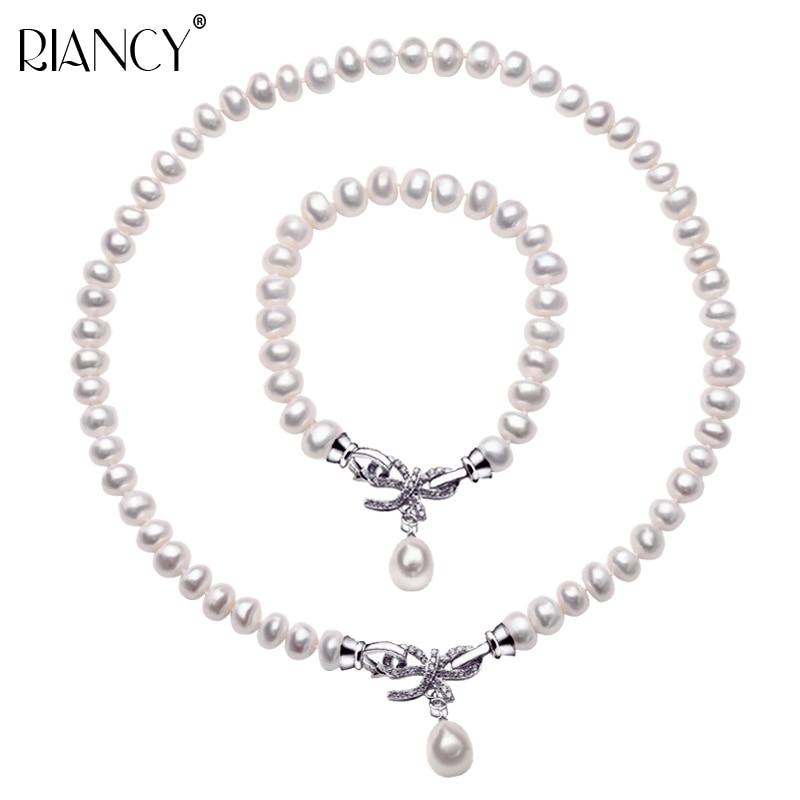 Ensembles de bijoux de perles de mode bijoux d'eau douce naturelle 925 en argent sterling arc collier de perles Bracelet deux ensembles pour les femmes cadeau