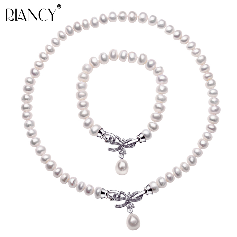 Fashion Pearl Jewelry Sets Natural Freshwater Jewelry 925 sterling silver Bow Pearl Necklace Bracelet Two sets For Women GiftFashion Pearl Jewelry Sets Natural Freshwater Jewelry 925 sterling silver Bow Pearl Necklace Bracelet Two sets For Women Gift