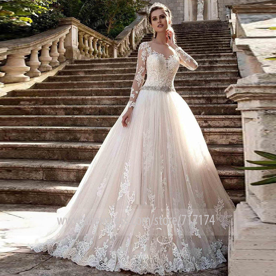 Sheer O Neck Long Sleeves Appliques New Vintage Lace Wedding Dresses with Sexy See Through Back Pearls Belt Vestios De Novia-in Wedding Dresses from Weddings & Events    1