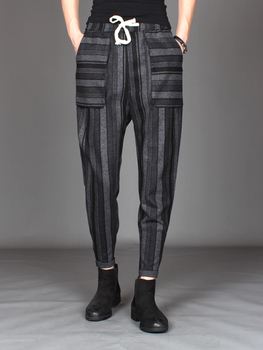 The 2018 new male Korean version of loose little feet color striped harem pants personality autumn and winter woolen casual pant