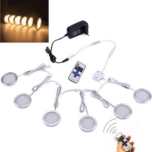 https://ae01.alicdn.com/kf/HTB1H48dQpXXXXXNapXXq6xXFXXX0/Linkable-Onder-Kast-LED-Verlichting-12-V-Dimbare-Puck-Lichten-met-Draadloze-RF-Afstandsbediening-Adapter-voor.jpg_640x640.jpg