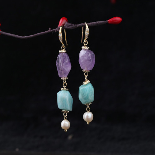 The designer hand made of natural stone irregular cut crystal pearl earrings