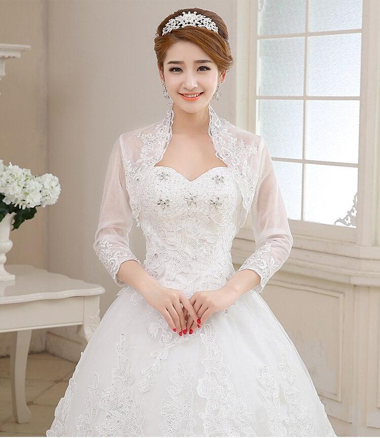 cf72057464 Sexy de tres cuartos decoración de la boda nupcial vestido de encaje Bolero  novia chaqueta de la capa para el vestido de boda de la fiesta Bolero en  Boda ...
