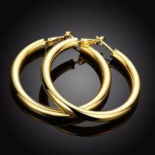 Женские свадебные серьги кольца большие круглые витые золотого