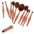 Nova 10 pcs Oval Conjunto de Pincel de Maquiagem Rosa escova de Dentes de Ouro Sereia Make Up Brushes Cosméticos Ferramenta