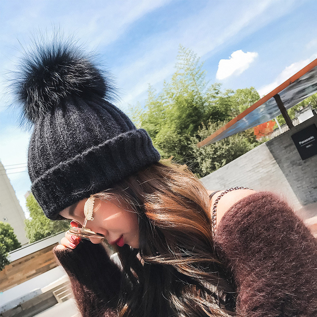 c178ca431a202 HT1333 New Women Winter Hats Knit Big Fur Pom Poms Beanie Hats Thick Warm  Female Slouch Cap Hat Black Red White Skullies Beanies