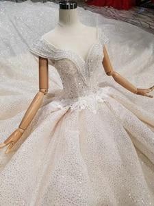 Image 4 - Ls11293 vestido de casamento especial cristal boné manga ilusão o pescoço feito à mão vestido de casamento ver através aberto voltar vistido