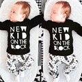 Novo 2017 baby boy roupas infantis algodão letra impressa longo t-shirt de manga comprida + calças recém-nascidos 2 pcs terno do bebê roupa da menina conjuntos