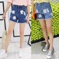 Плюс размер джинсы шорты женские летние стиль 2016 бермуды feminina свободные отверстия печати кисточкой тонкий джинсовые шорты женский A1240